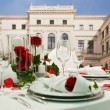 Covered banquet with red roses decoration — Stock Photo