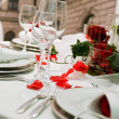 Covered banquet with red roses decoration — Stock Photo #4040311