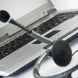 Headset with laptop - Stock Photo
