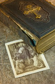 Old bible with picture of saints — Stock Photo