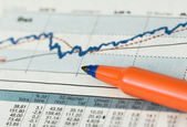 Share chart with pen — Stock Photo