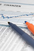 Share chart with pens — Stock Photo