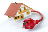 Model house with red plug — Stock Photo
