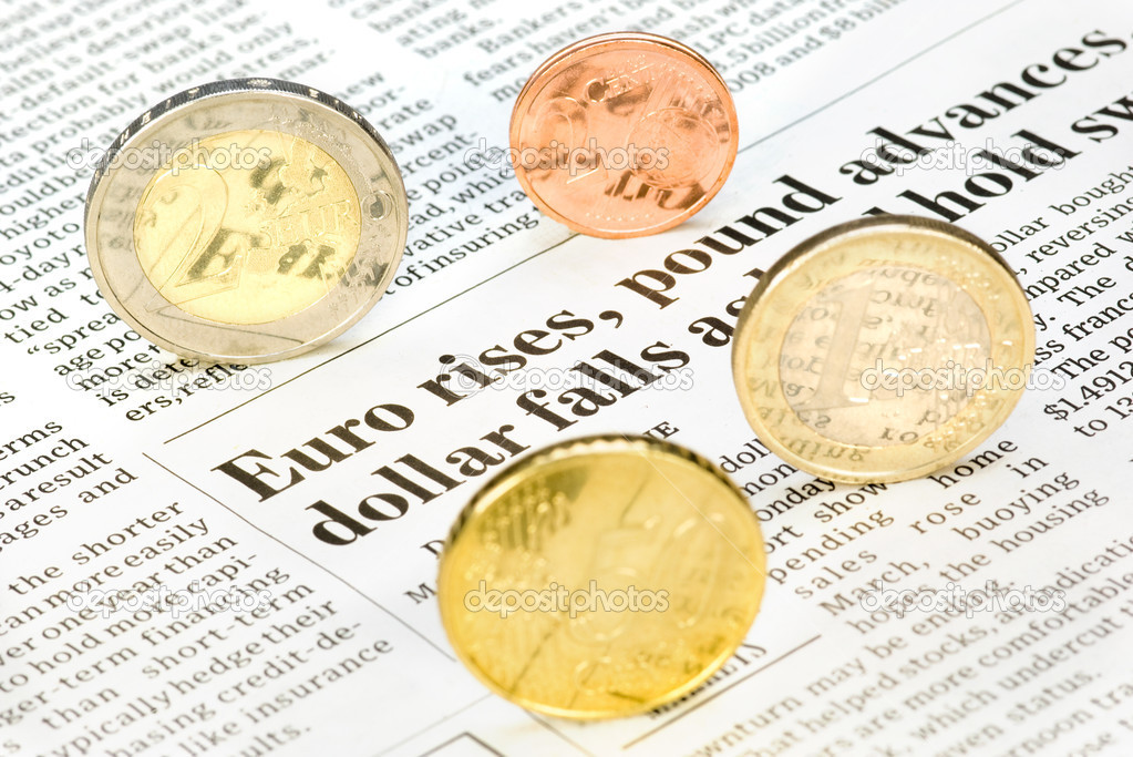Euro-coins rolling over a newspaper  Stock Photo #4045335