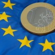 Euro coin on european flag — Stock Photo