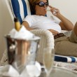 Relaxing woman with champagner bucket — Stock Photo