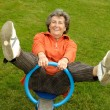 Stock Photo: Senior womon seesaw