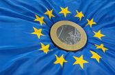Euro coin on european flag — Stock Photo