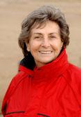 Senior woman with red windbreaker — Stock Photo