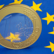Euro coin on a european flag — Stock Photo #4085659