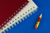 Short pencil and notepads — Stock Photo