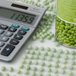 Peacounters wokplace with peas, pea tin and calculator — Stock Photo #4097715
