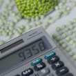 Peacounters wokplace with peas, pea tin and calculator — Stock Photo #4097745