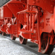 Red wheels of a vintage steam locomotive — Stock Photo