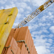Stock Photo: Crane and wall on construction site