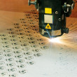 Stock Photo: Industrial laser cutter at work