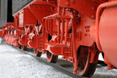 Red wheels of a vintage steam locomotive — Photo