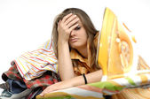 Frustrated young woman at the ironing board — Stock Photo