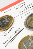 Euro coins on a bank account — Stock Photo