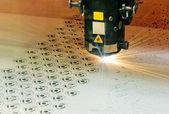 Industrial laser cutter at work — Stock Photo