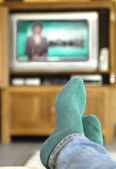 Watching TV on the couch — Stock Photo