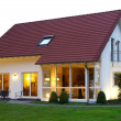 Family house in the dawn - Foto Stock