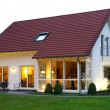 Family house in the dawn - Stok fotoğraf