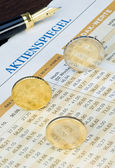 Euro coins on a finance chart — Stock Photo