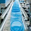 Mass production of plastic containers — Stock Photo #4140514