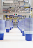 Mass production of plastic cups — Stock Photo