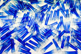 Blue plastic tubes — Stock Photo