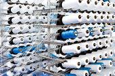 Spools of thread on a loom — Stock Photo
