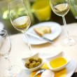 Dining table with white wine glasses — Stock Photo
