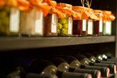 Wine bottles in a rack — Stock Photo