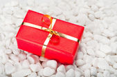 Gift Box on Stones — Stock Photo