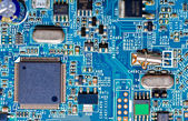 Close-up photograph of a blue circuit board — Stock Photo