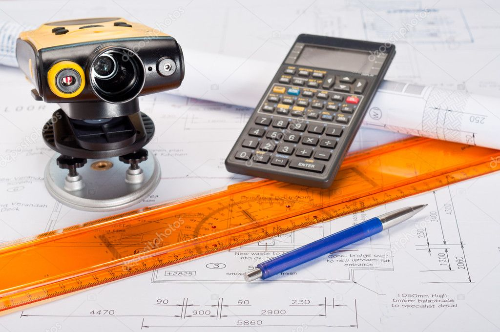 Building plans with laser distance measurement device and calculator — Stock Photo #4642736