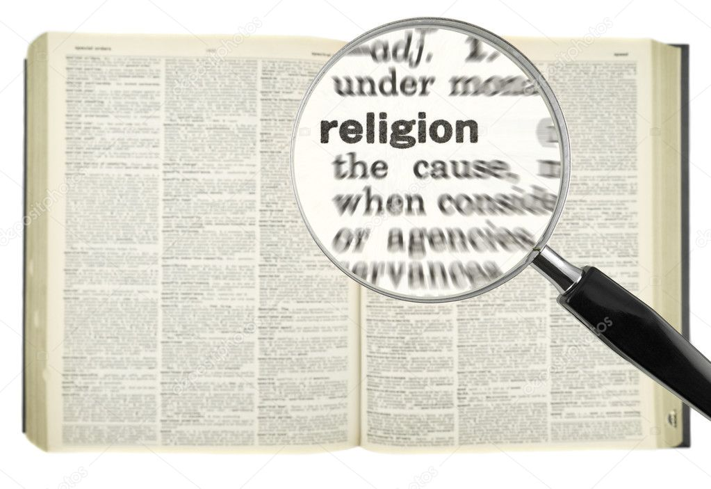 A magnifying glass on the word RELIGION on a dictionary. — Photo #4179251