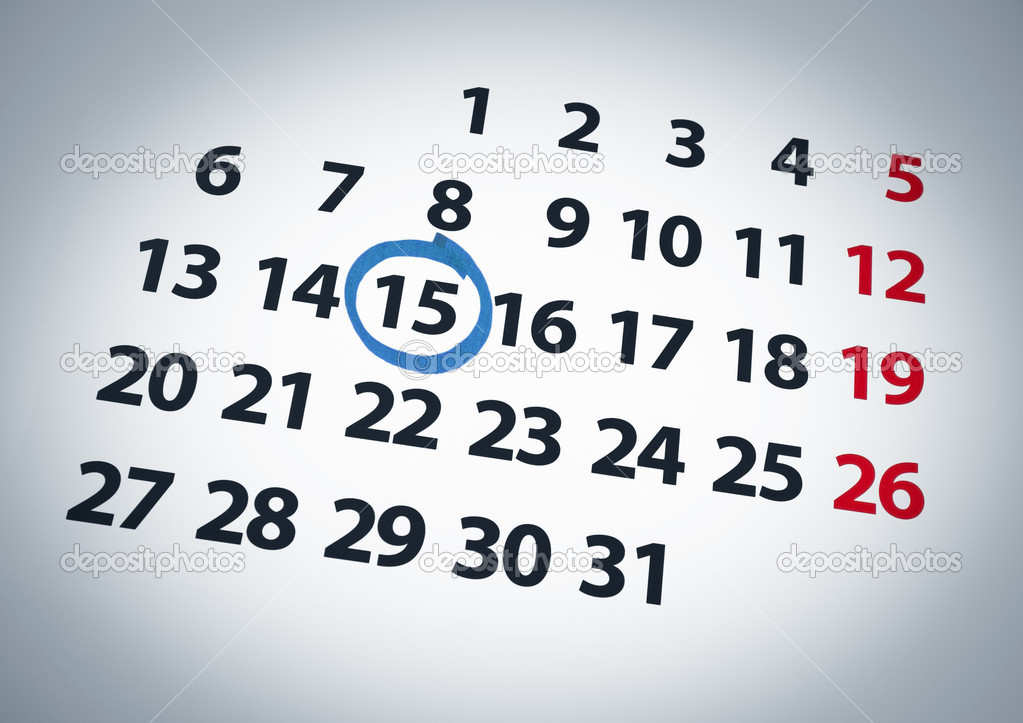 A date circled on a 15th day of a calendar with blue ink.  Stock Photo #4521516