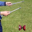 Playing diabolo - Stock Photo