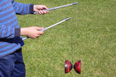 Playing diabolo — Stock Photo