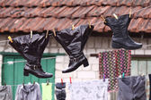 Shoes on the clothesline — Stock Photo