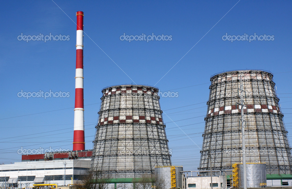 Power station with chimney and cooling towers against clear blue sky — Stock Photo #3924577