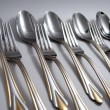 Metal spoons and forks - Stock Photo