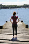 Girl watching the ocean — Stock Photo