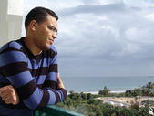 Tunisian man watching the ocean — Stock Photo