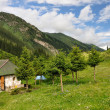 Colorful mountain hut in Altyn-Arashgorge with sky and clouds — Stock Photo #3960001