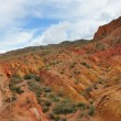 Startling Red canyons in Kyrgyz mountain - Stock Photo