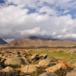 Boulders and clouds in Kyrgyz mountains — Stock Photo