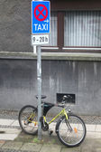 Yellow bicycle on taxi parking — Stock Photo